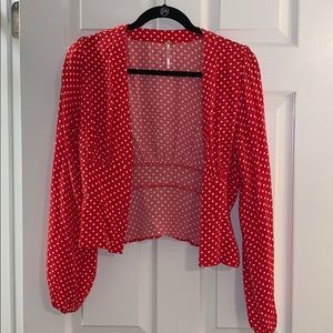 Red and white polka dot long sleeve top